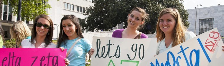 Photo of sorority members with signs